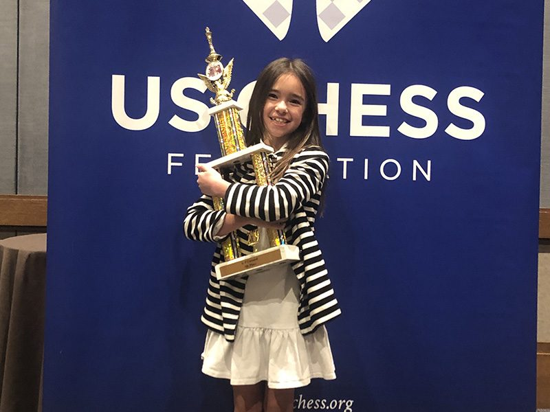Lee-Ann with her first chess trophy, April 2019